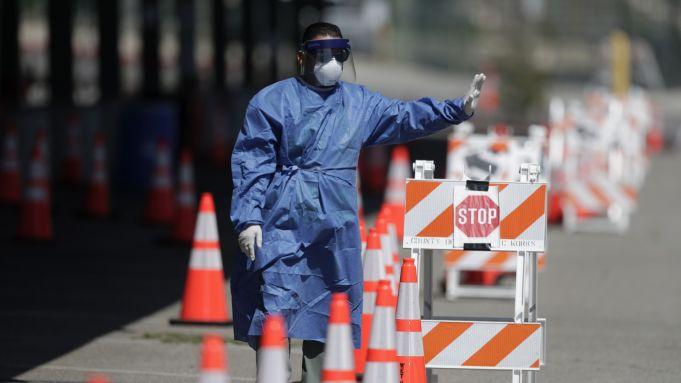Sen Doug Jones: 'I'm Scratching My Head' Over Trump Saying Number of U.S. Virus Cases Is a 'Badge of Honor'